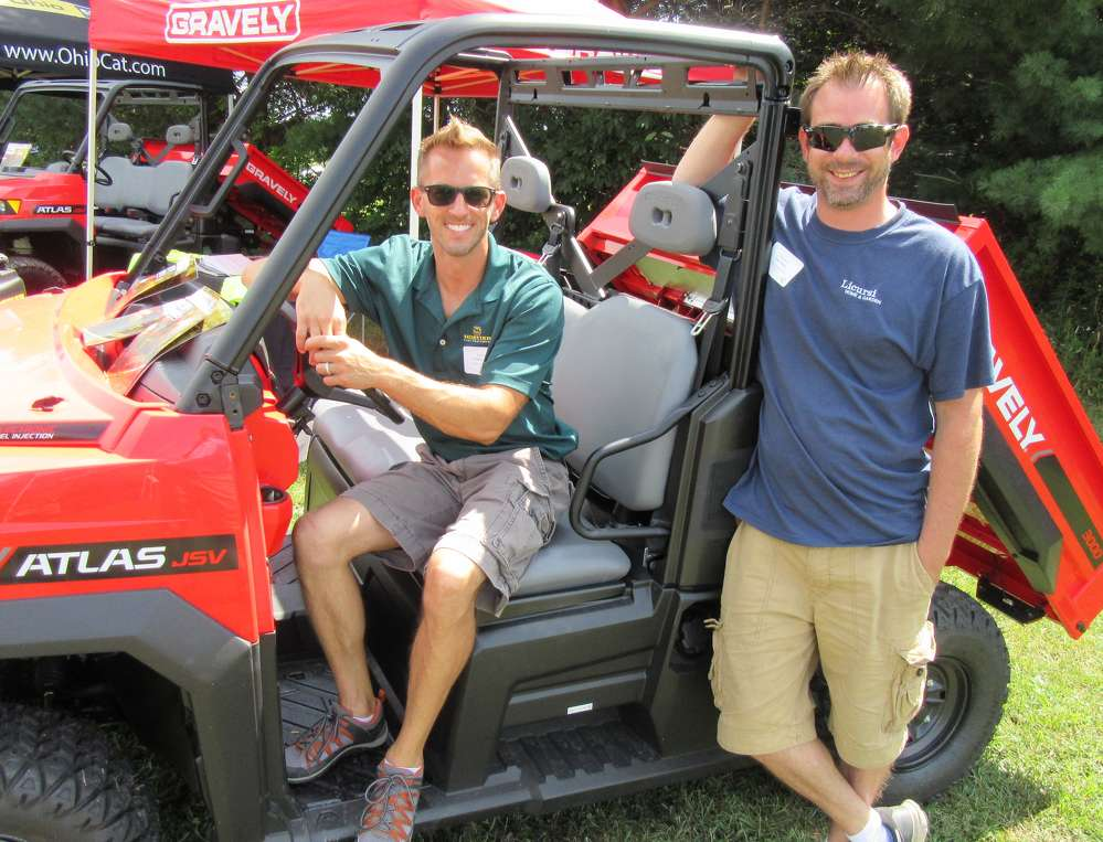 Anthony Licursi (L) and Tim Walker, both of Licursi Garden Center, spoke with attendees about this Gravely Atlas JSV 3000 jobsite utility vehicle.