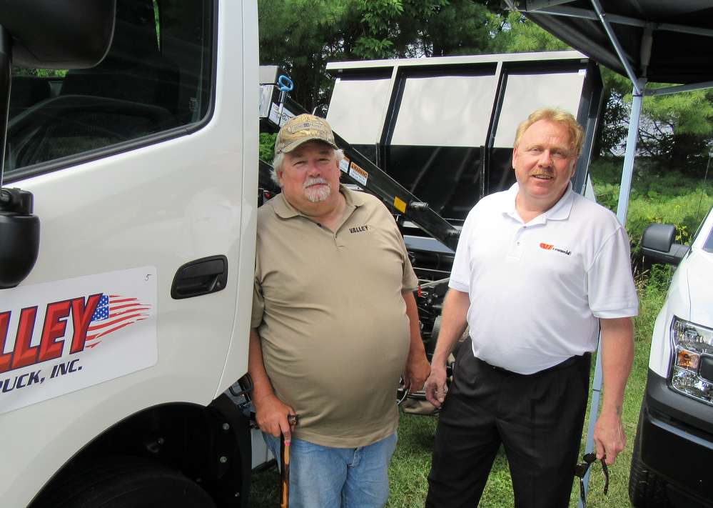 Joe Dawson and Jim Burkhammer of Cenweld Truck Bodies & Equipment stand at the Valley Ford Truck Sales equipment display.