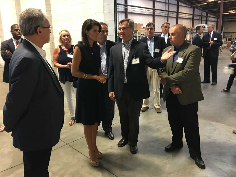 David Calder points out a few of their manufacturing techniques to Gov. Nikki Haley.