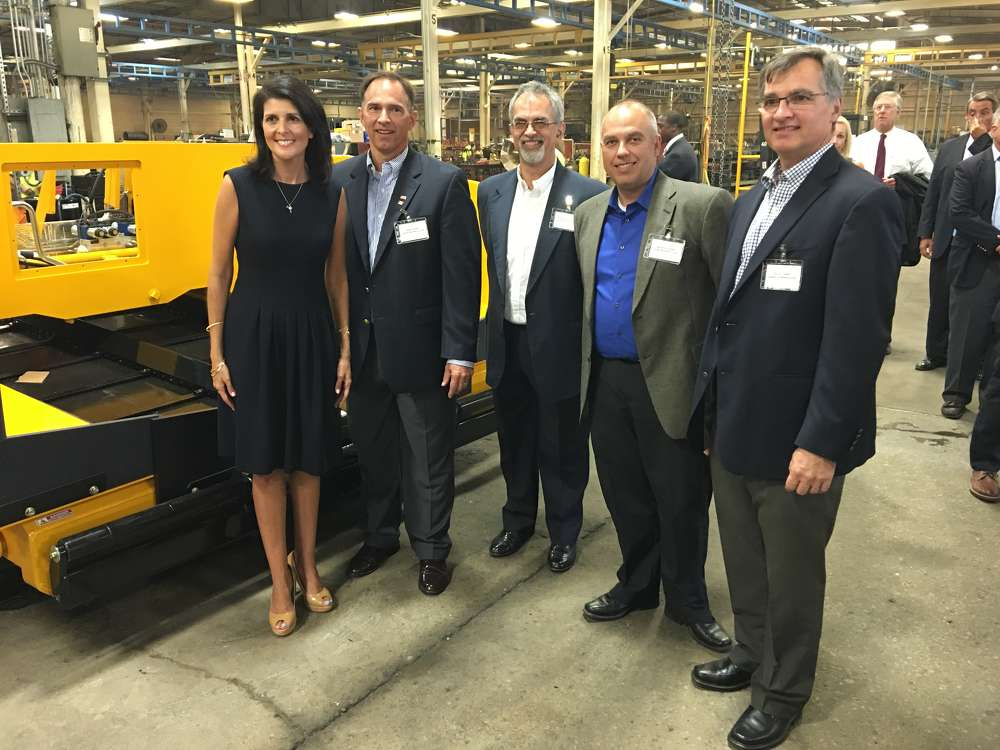 (L-R): Gov. Nikki Haley and Glen, Wayne, Cameron and David Calder stand in front of a Mauldin 1750C that is on the assembly line.
