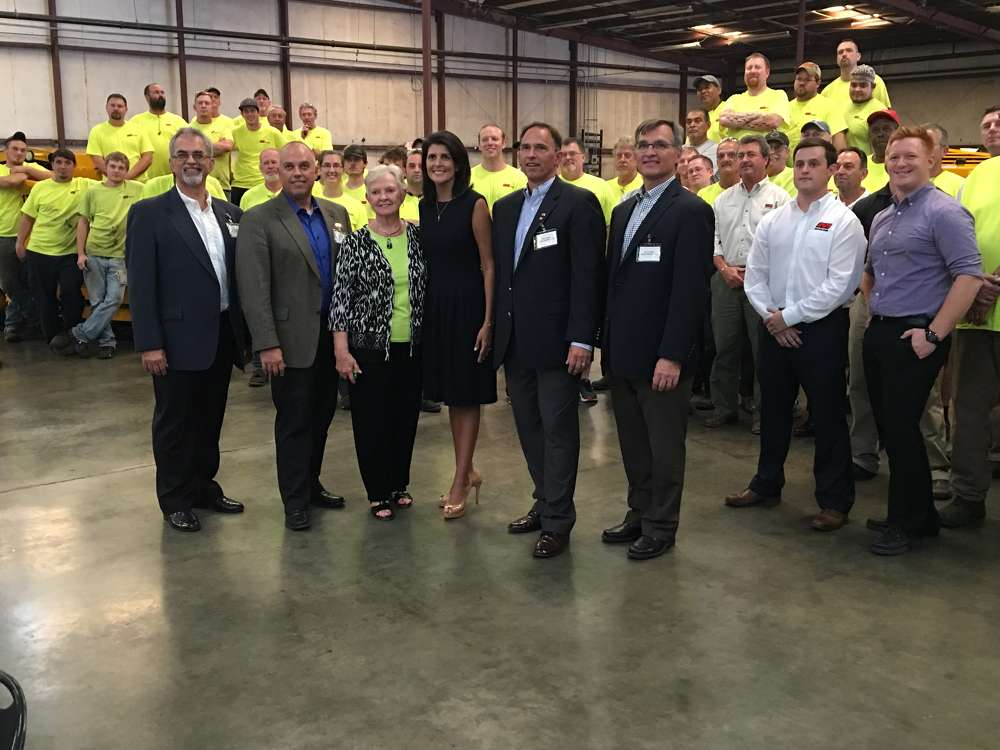 (L-R): Wayne, Cameron and Marjorie Calder, Gov. Nikki Haley and Glen and David Calder stand with the Calder Brothers Manufacturing team.