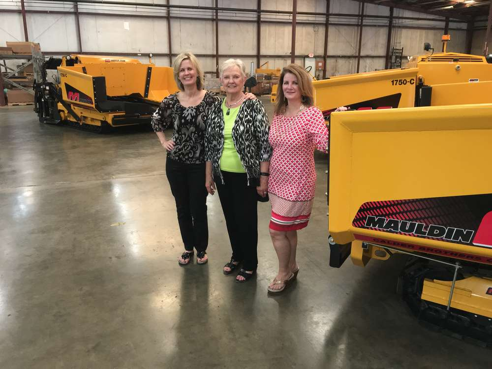 Tammy, Marjorie and Sally Calder stand in front of the company's Mauldin Paving products.