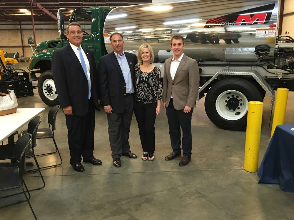 (L-R): South Carolina State Sen. Ross Turner; Glen and Tammy Calder; and Mike O'Brien, Association of Equipment Manufacturers stand in front of this Mauldin Precision Spray 2000 distributor.