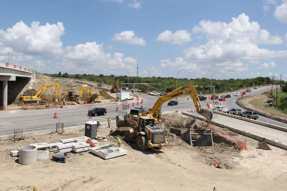 Central Texas Regional Mobility Authority photo .Crews perform utility work near the Springdale Road Bridge.