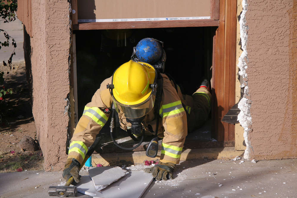 Because of structures the Arizona Department of Transportation has acquired in the future path of the  South Mountain Freeway, probationary firefighters with the Rural/Metro Fire Department were able to practice what's known as a mayday scenario.