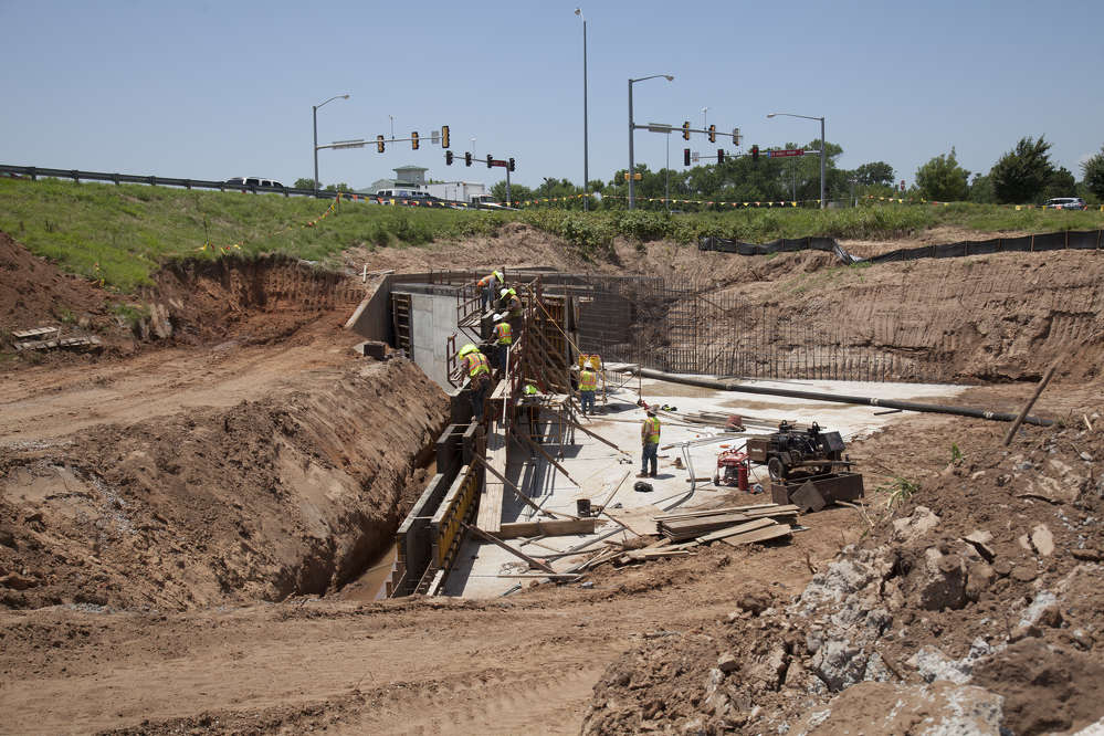 ODOT photo. Workers will reconstruct the north half of the I-35 and SH-9 East Interchange with new ramps and connect Ed Noble Parkway from Lindsey Street to SH-9 East.