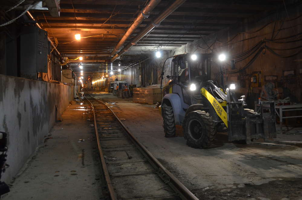 The Wacker Neuson 5055 loader parked next to the tracks that it has to navigate each day.