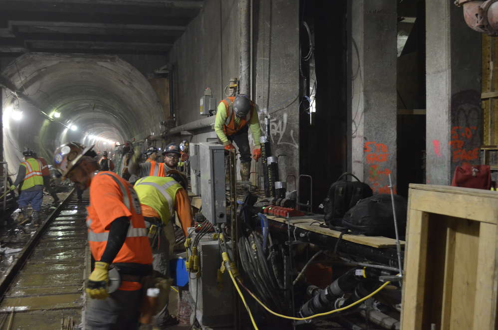 Frontier-Kemper laborers in the process of building one of the cast-in-place concrete duct benches/walkways.
