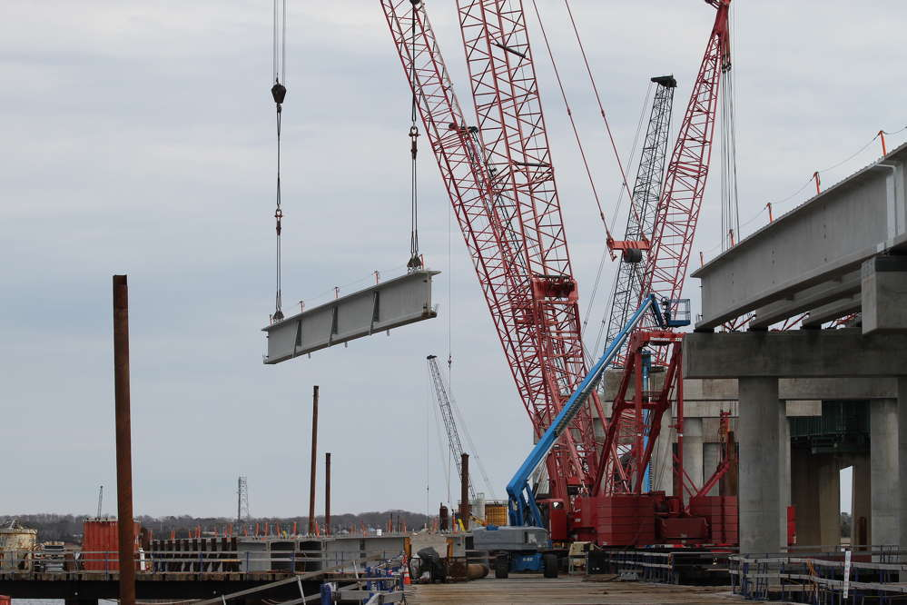 Twin Manitowoc 2250s erected girders from trestle.
