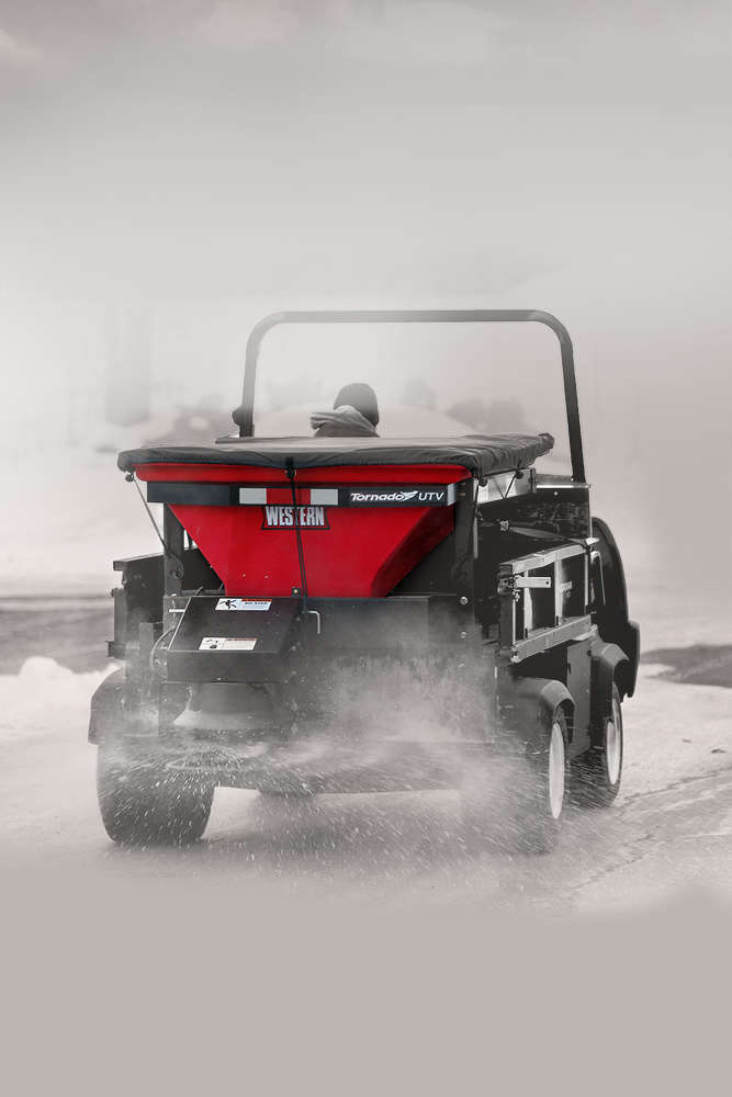 The Tornado UTV spreader is built with a standard inverted vibrating V for maximum material agitation, a standard top screen to help break up large chunks of de-icing material while loading, a heavy duty steel frame with electrostatic powder-coated finish, and a fitted tarp cover that helps ice control material stay dry to prevent clumping.