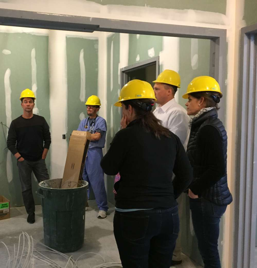 ER physicians review the new space.