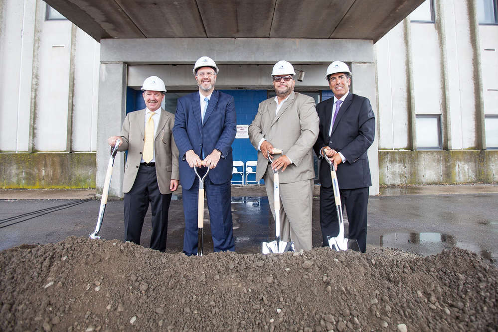 McInnis Cement executives and Rhode Island officials gather to officially break ground at the new cement company's first U.S. terminal in the Port of Providence.