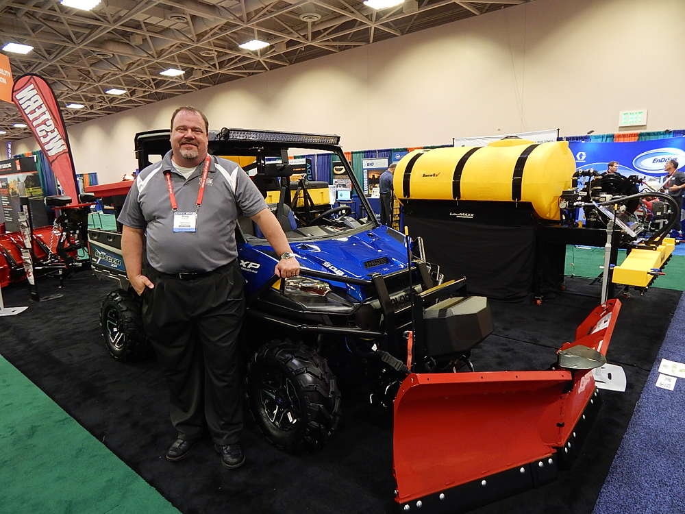 Douglas Clark, product manager, Douglas Dynamics, talks to guests about the features of this UTV V-Plow with Western UTV Tornado 11-ft. (3.3 m) hopper.