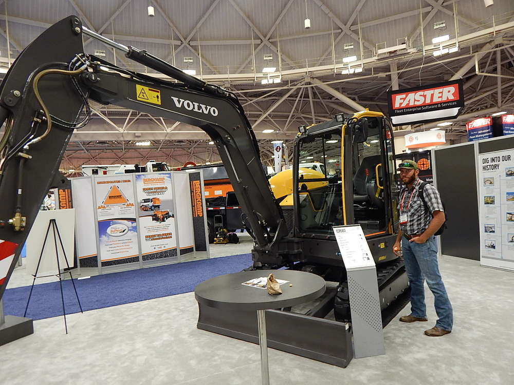 Jason Benzel, Yuba City, Calif., public works maintenance manager, looks at this Volvo CCR58D compact excavator.