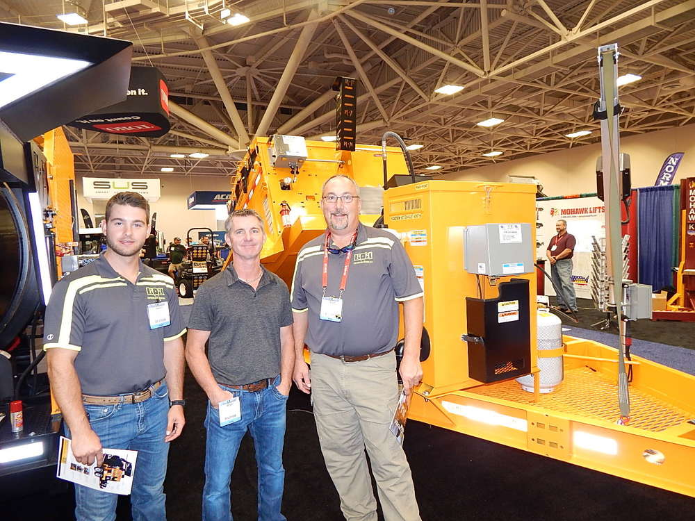 (L-R): Aaron Barla, sales representative; Bryan Burke, CEO, and Kurt Schwartz, territory manager, all of KM International with their KM 8000 TED. Schwartz said this was a great show, lots of great information was provided and there was both national and local attendance.