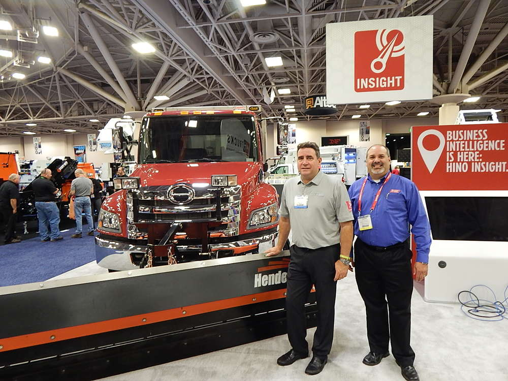 Spencer Nicol (L), Hino Trucks senior manager, and Carlos Fernandez, municipal sales representative, Allstate Peterbilt, St. Paul, Minn., share a laugh and talk about this Hino 2508ALP.