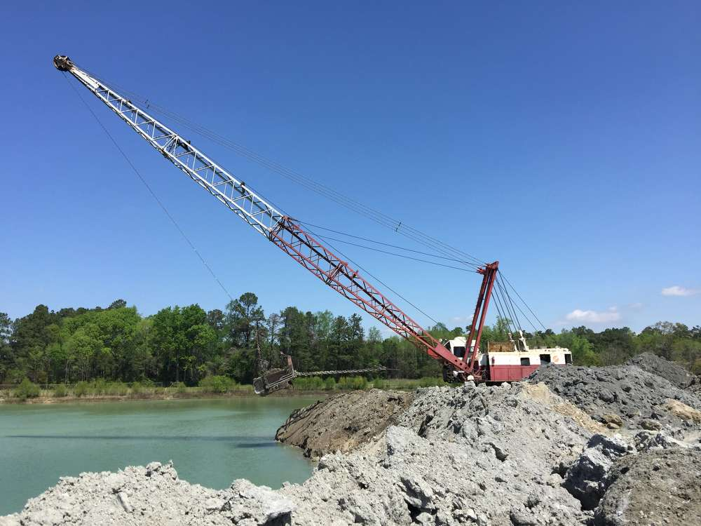 The company's other off-road trucks move the limestone, extracted by two Manitowoc 4600 draglines from under water, to the crushing plant after the rock has been allowed to properly dry.
