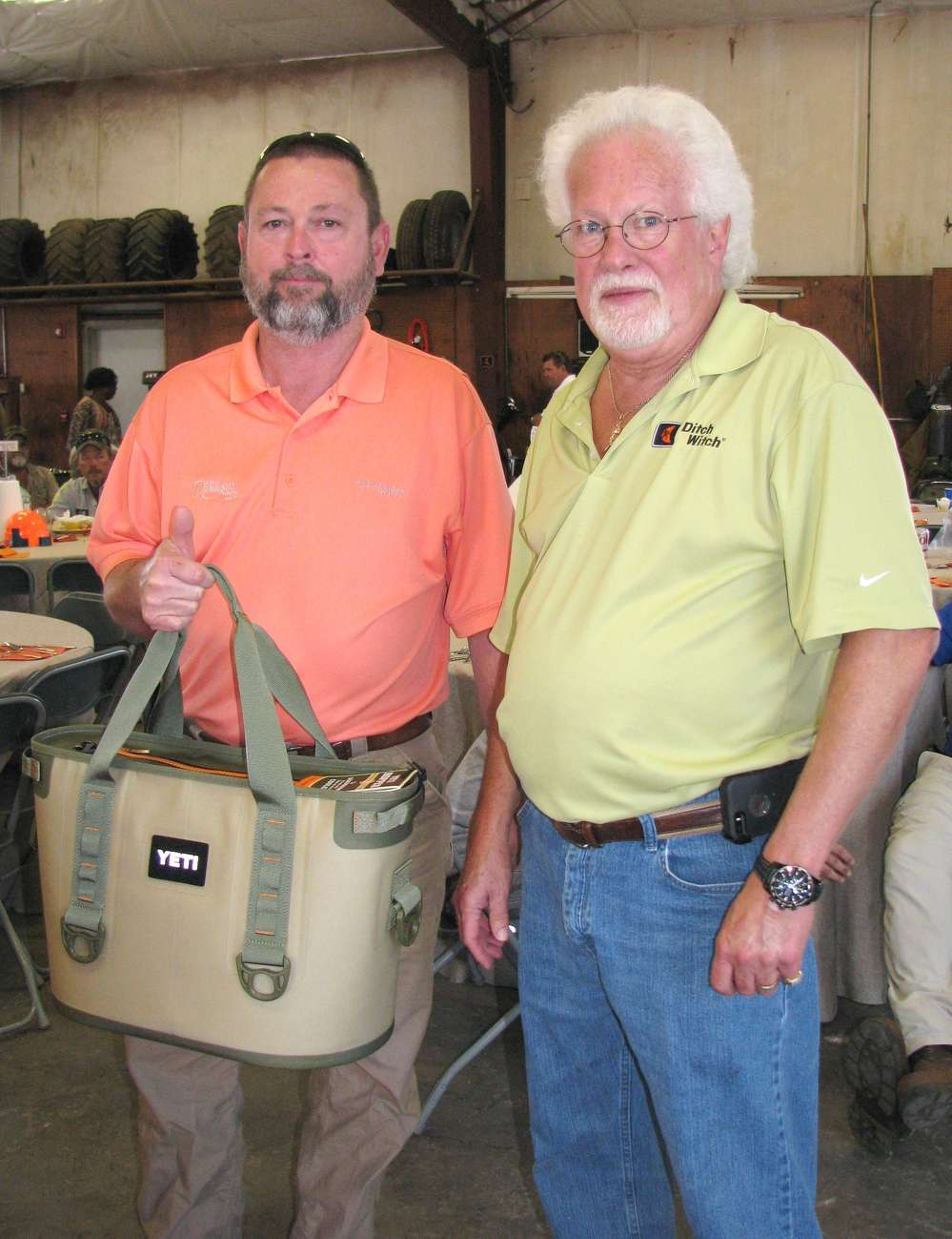 Marty Thornton (L) of the city of Douglas, Ga., stopped in for lunch and won a Yeti soft side cooler, which was presented to him by Ricky McCrary, Ditch Witch of Georgia, branch manager.