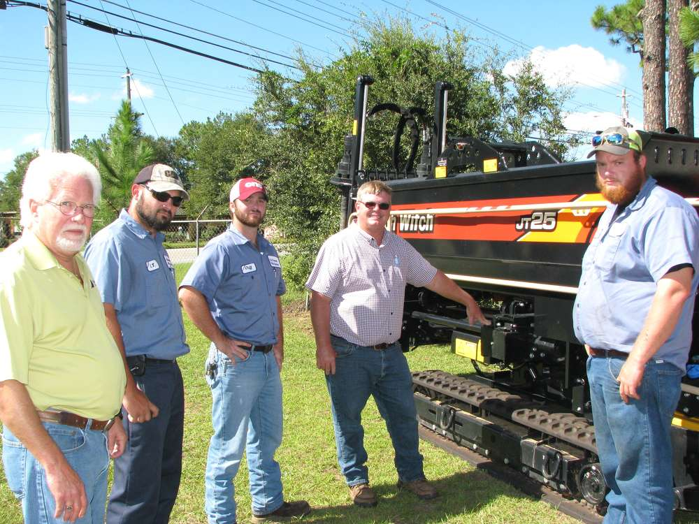 (L-R): Ricky McCrary, Ditch Witch of Georgia, goes over the features of a Ditch Witch JT25 directional drill with Archie Carson and Cliff Ouzts, city of Thomasville, Ga., utilities department; Gary Morris, Ditch Witch of Georgia; and James Williams of the city of Thomasville.