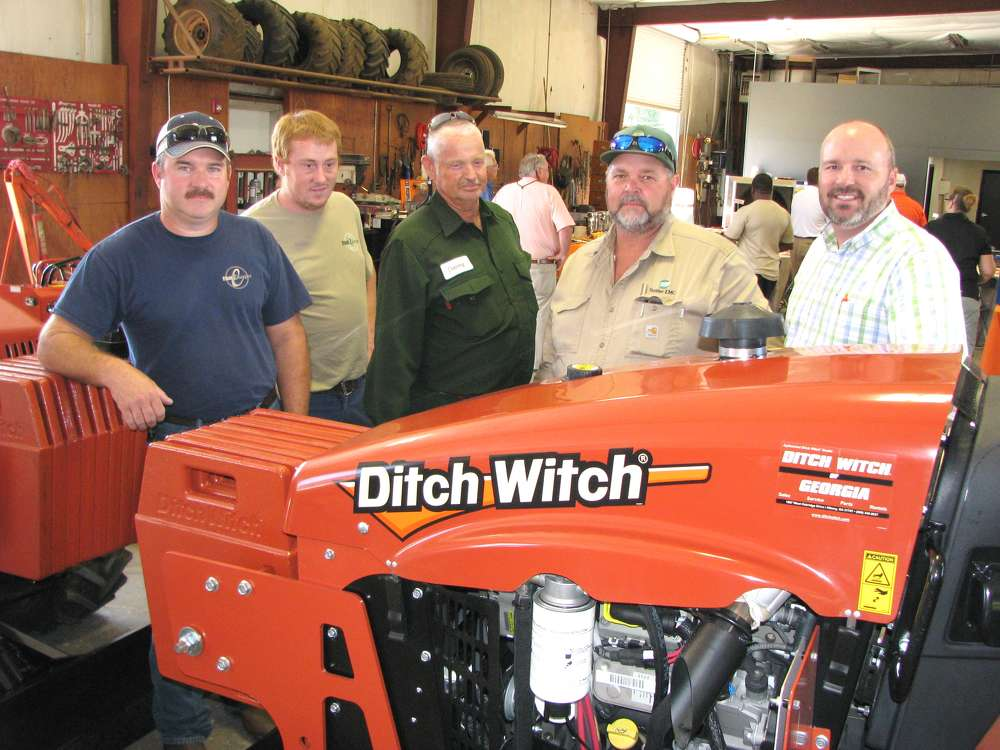 (L-R): Tory Wilson and David O'Neal of Flint Energies, Reynolds, Ga.; Danny Wingard and Wendell Nealey of Sumpter EMC, Americus, Ga.; and Todd Human, Ditch Witch of Georgia, look over RT45 trenchers on display in the shop area.