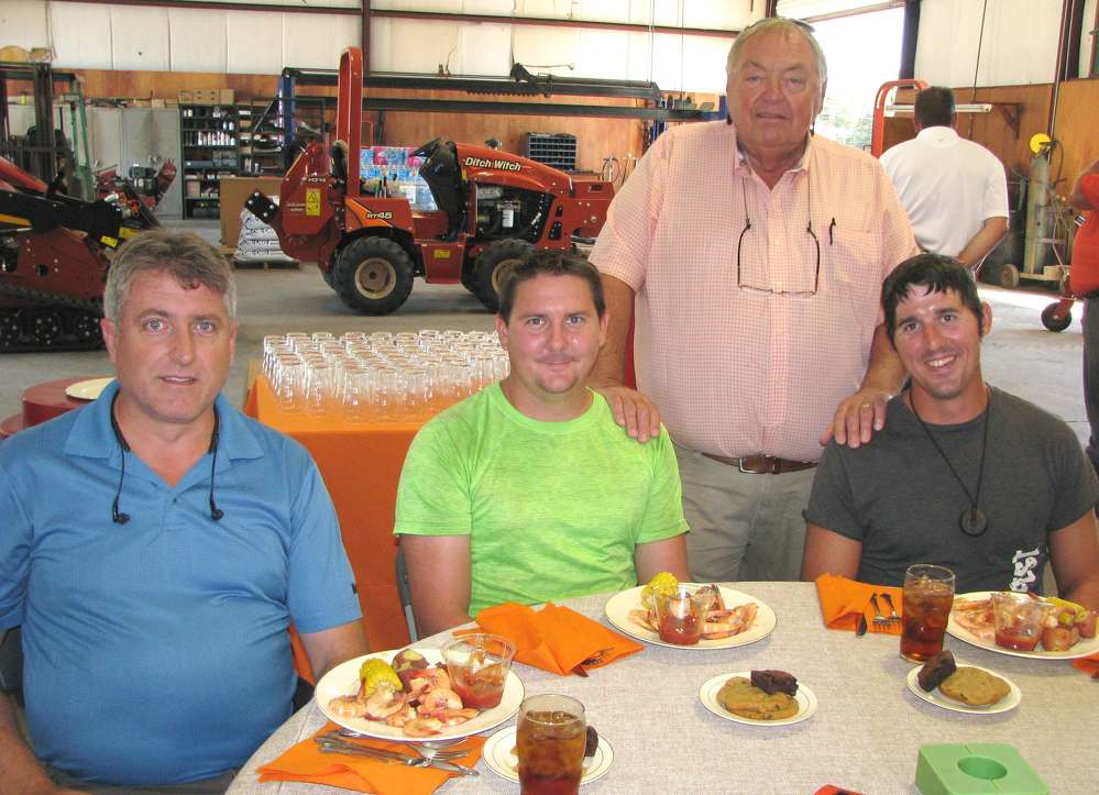 Wade Bailey (standing), Ditch Witch of Georgia general manager, greets some of his guests including (L-R) Richard Michaels, Jared Perone and Jeshimon Perone, all of AAA Sprinkler Systems, Albany, Ga.