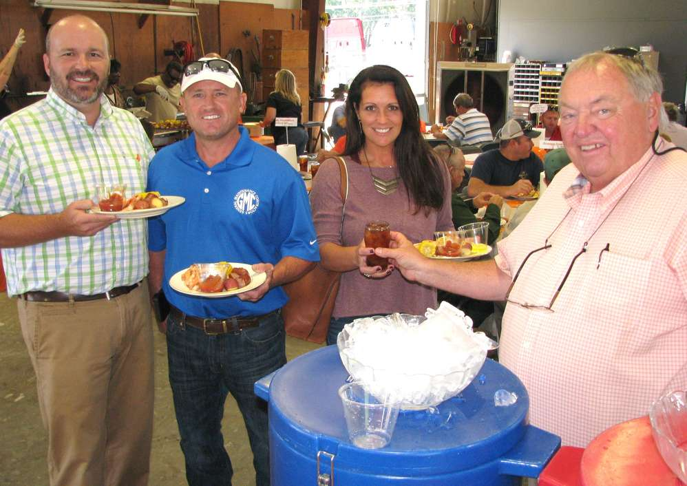 Wade Bailey (R), Ditch Witch of Georgia general manager serves sweet tea to staffers and guests including (L-R) Todd Human, Ditch Witch of Georgia, and Jamie and Shannon Delamar, both of General Maintenance Contractors, Opelika, Ala.