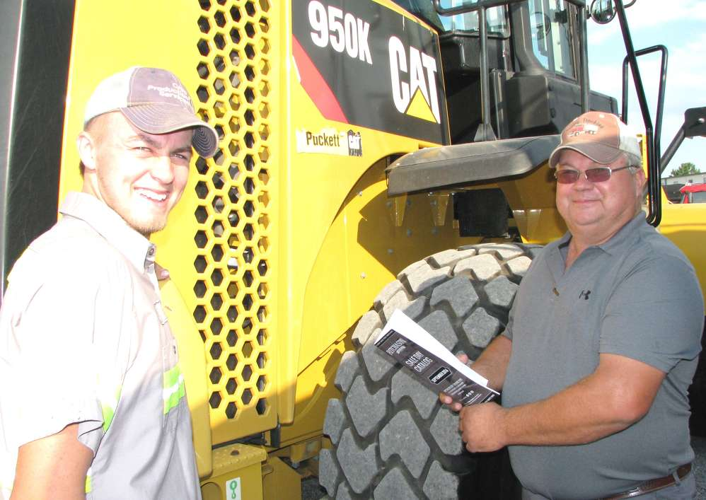 William (L) and Jeff Ratley, both of Jeff Ratley Trucking, Morganville, Ky., talk about this late-model Cat 950K wheel loader.
