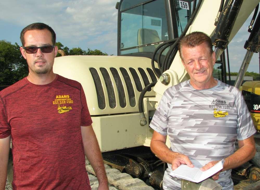 Mekya (L) and Randy Adams, both of Adams Construction, Coalmont, Tenn., consider bidding on equipment.
