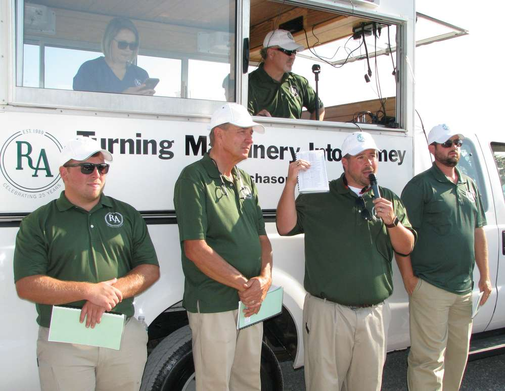 (L-R): Eric Phillips, Dewain Ritchason, Daniel Pruitt and Chad Boyce, all of Ritchason Auctioneers, prepare rings 2 and 3 for the sale.