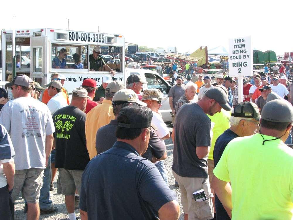 Registered bidders vie for equipment.