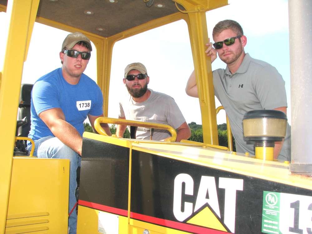 (L-R): Mathew Jordan, Jordan Excavating, Murfreesboro, Tenn.; Jack Lane, Lanes Farm Trucking & Excavating, Lascassas, Tenn.; and Thomas Burgess, Burgess Land Clearing, Murfreesboro, Tenn., check out this Cat D3C dozer.