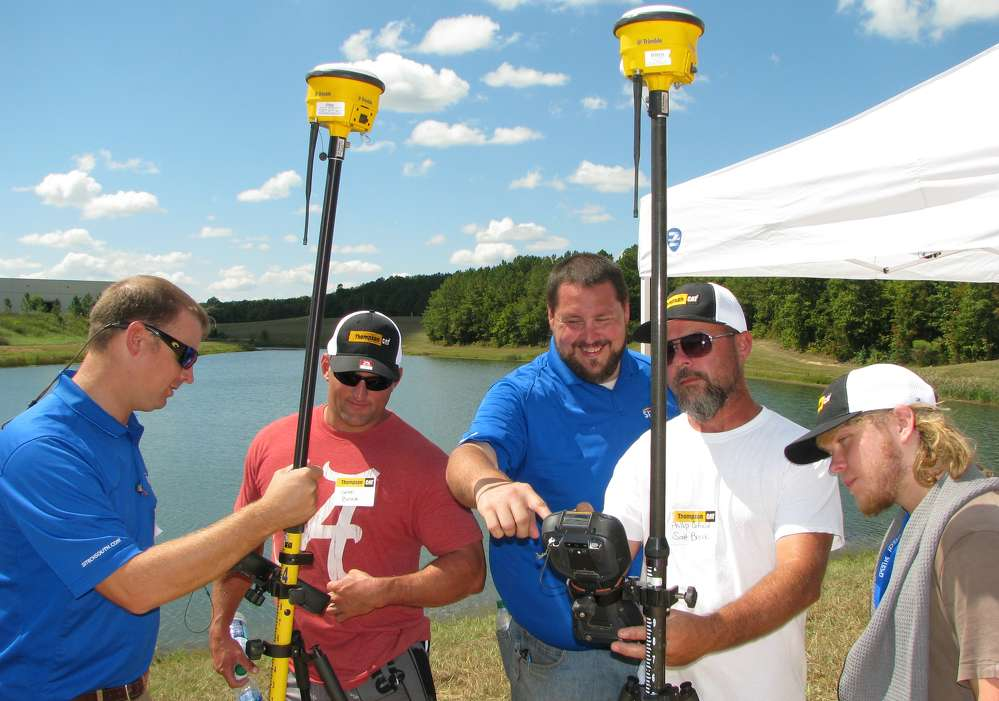(L-R): Jonathan Dunlap, Sitech South; Seth Brock, Minuteman Construction, Cullman, Ala.; Chad Davis, Sitech South; and Phillip Cofield and Tyler Brock, also of Minuteman Construction, engage in a hands-on demo of some of the Trimble products.