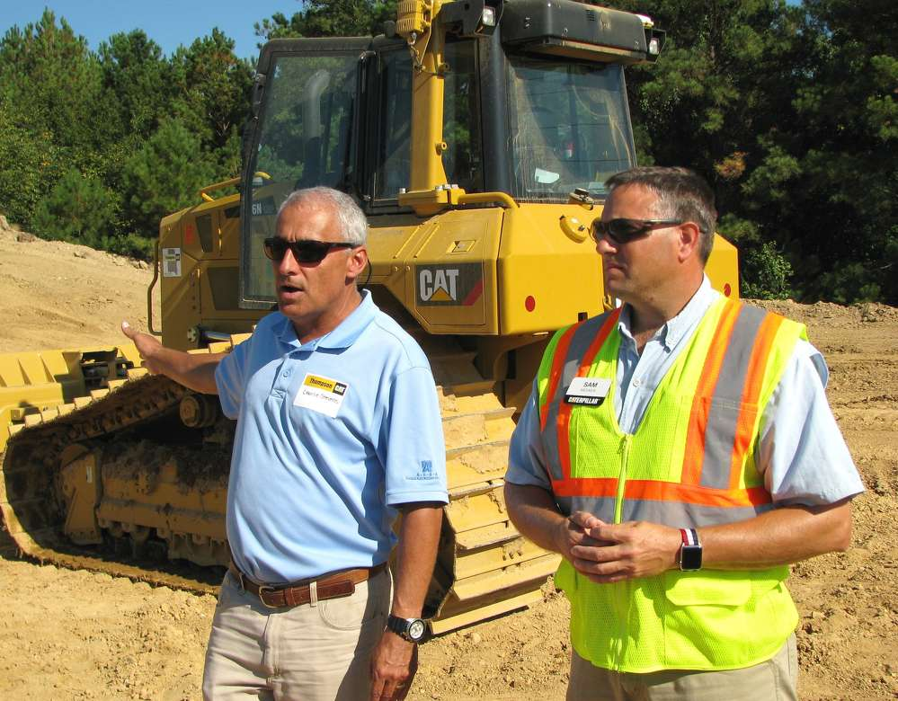 Charlie Stevens (L), Thompson Tractor, and Sam Meeker, Caterpillar, provide preliminary information on the D6N machines with integrated advanced Cat GRADE technologies before the demo began.