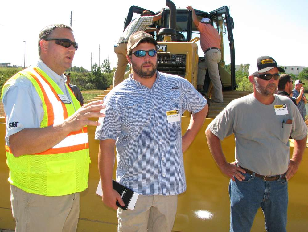 (L-R): Sam Meeker, Caterpillar, speaks to Clint Carter and Tim McKinney, both of MS Industries, Wolf Springs, Ala., about the capabilities of the newest D6N dozers during the demo.