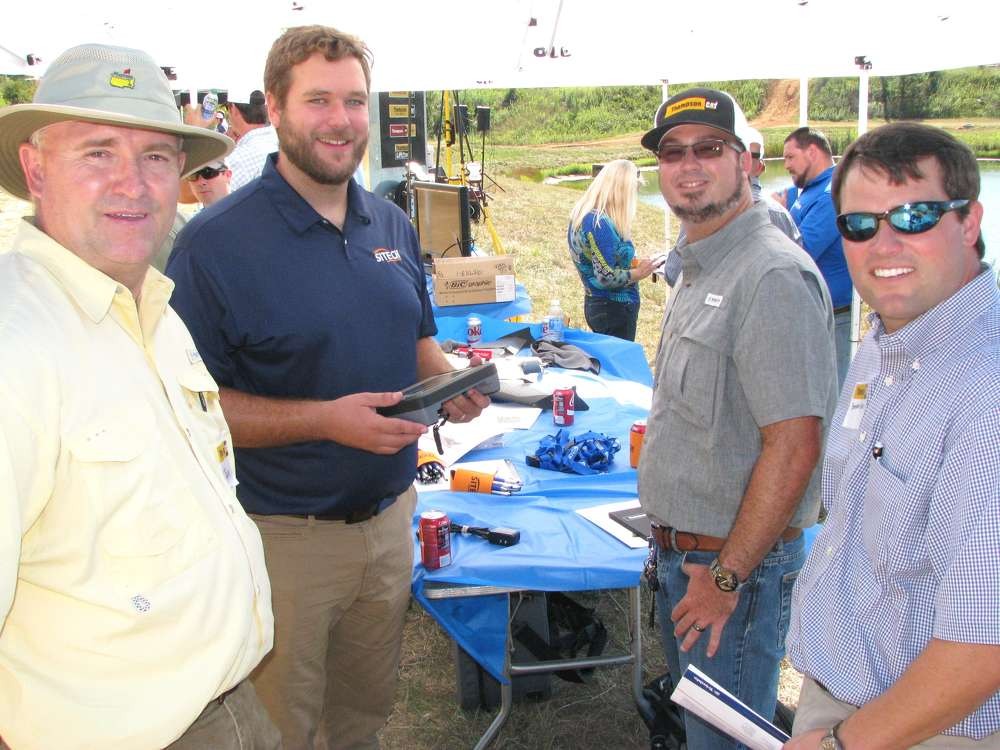 (L-R): Lin Roberts, Thompson Tractor, Montgomery, Ala.; Matt Rosenbalm, Sitech South, Smyrna, Ga.; and Brian Self and Brandon Owens, Wiregrass Construction Company, Dothan, Ala., look over the control of the Trimble UX5 survey drone.