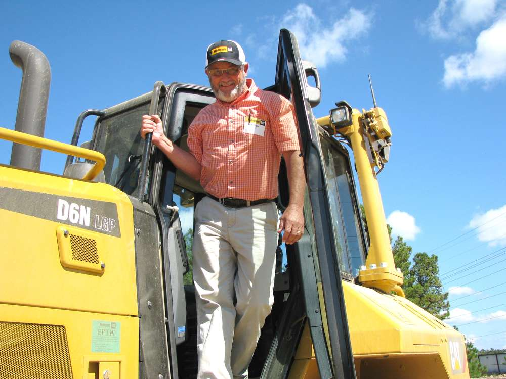 "Matt Payne of Goodgame Co. Inc., Pell City, Ala.,  exits the cab of the D6N dozer and said, ""that's a nice machine."""