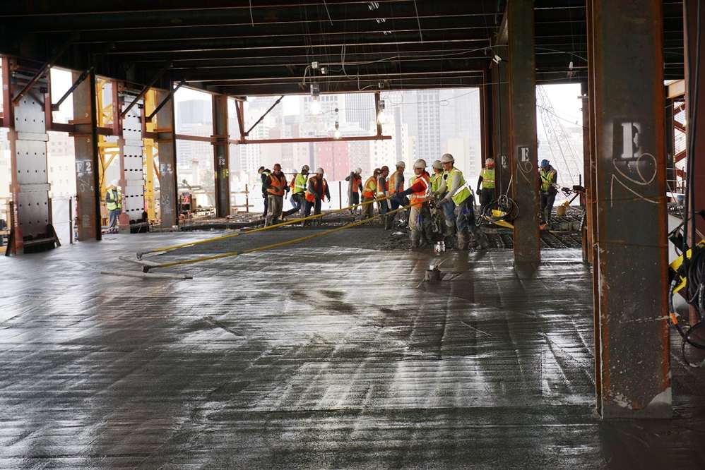 Crews pour the concrete floor of the Van Ness and Geary Campus hospital.