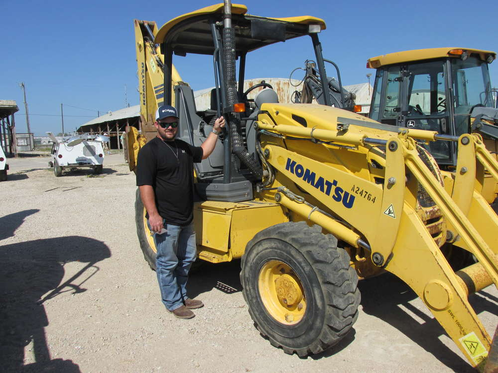 Jonathan Jones of Decatur, Texas, an independent dirt contractor, plans to bid on this Komatsu WB146 loader/backhoe to use on one of his projects.