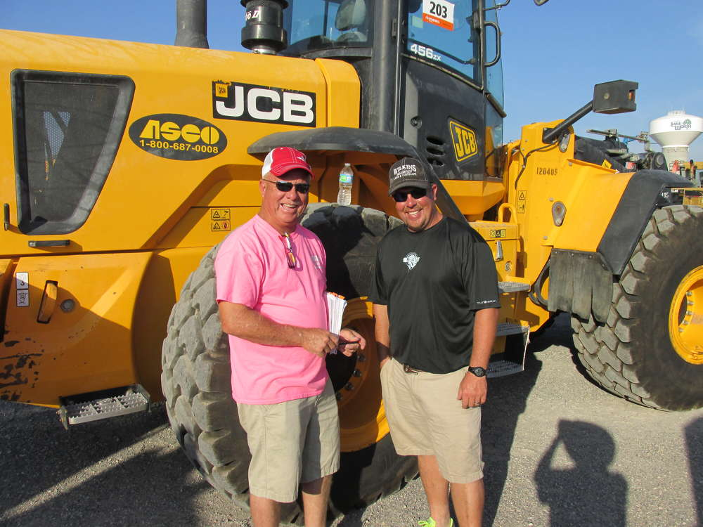 Dale (L) and Jeremy Wilkins of Wilkins Lawn and Landscape in Ardmore, Okla., would like to take this JCB 456 loader back to Oklahoma with them.