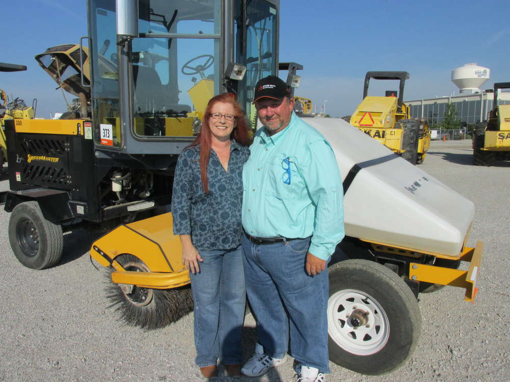 Karen (L) and Danny Whiddon of Seismic Contractors LLC, Corinth, Texas, are enjoying the day and looking at this 250 Sweepmaster.