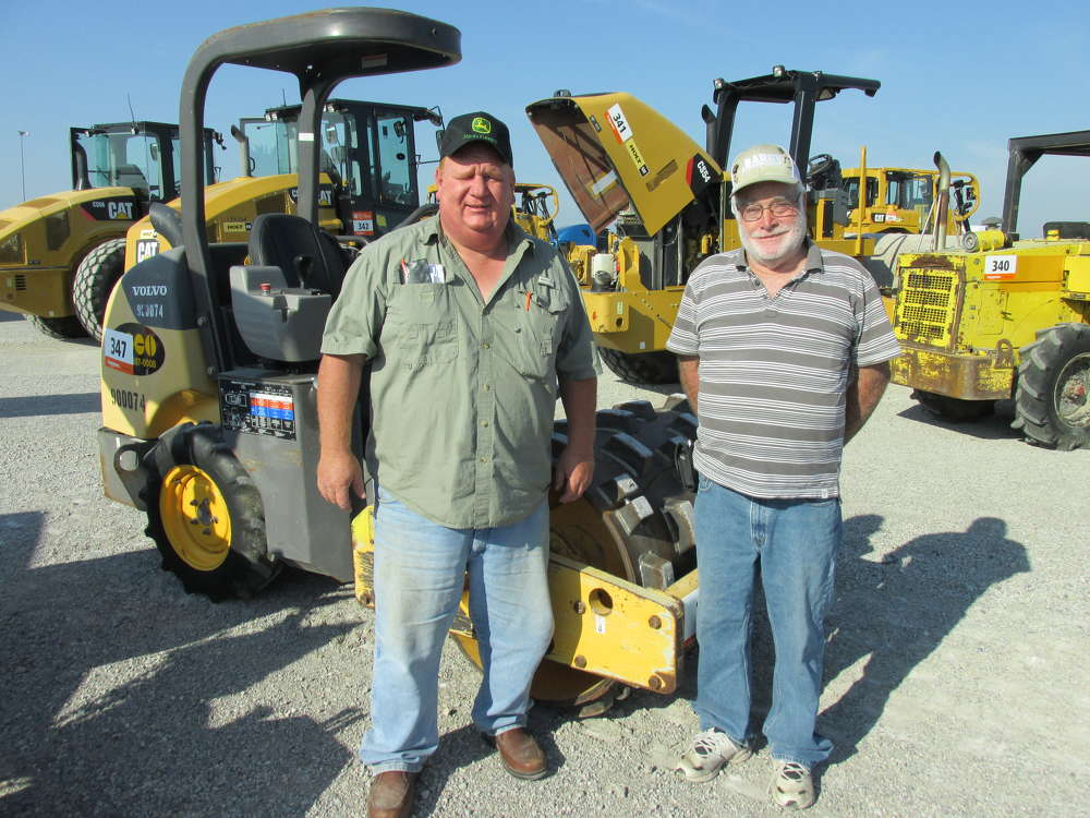 Scott Turner (L) and Jerry Lane of Scott Turner Construction in Hempstead, Texas, are impressed with this Volvo SD 25 pad-foot, vibratory loader.