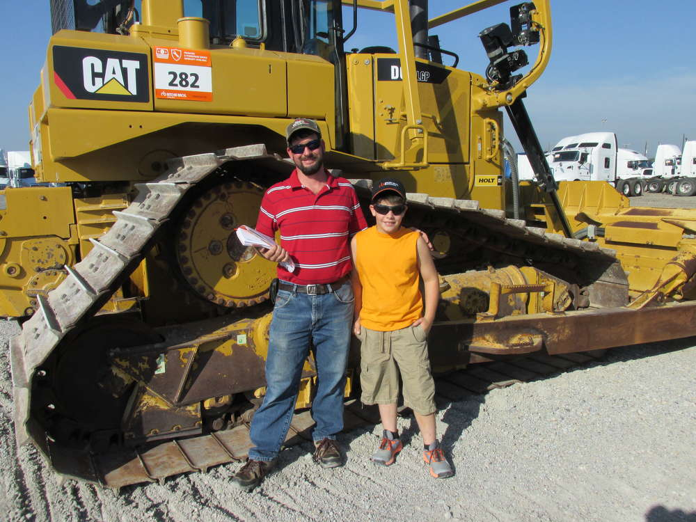 Albert Headings (L) and his son, Kayden, an independent contractor in Rose, Okla., think this Cat D6 dozer will be perfect for his next job.