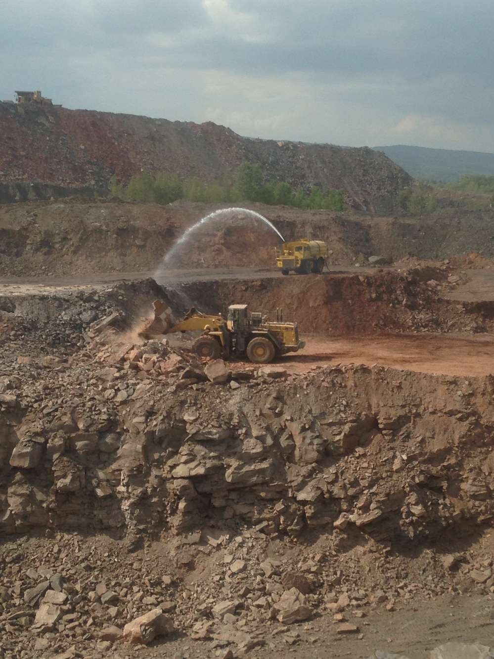 Earthmovers Unlimited Inc. photo. Earthmovers also has constructed an onsite water system with a capacity to hold 500,000 gal. (1.8 million L) to use, along with fire retardant foam, to extinguish the fire.