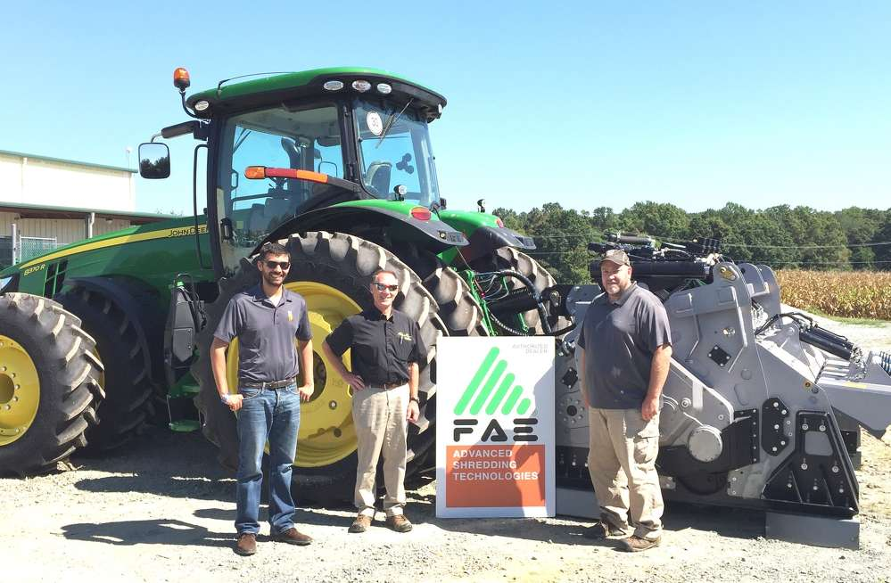 (L-R): FAE USA's Stephen Leghissa; Atlantic Tractor's Gary Sorrelle; and FAE USA's Lee Smith stand in front of a JD 8370 with an FAE MTH attachment.