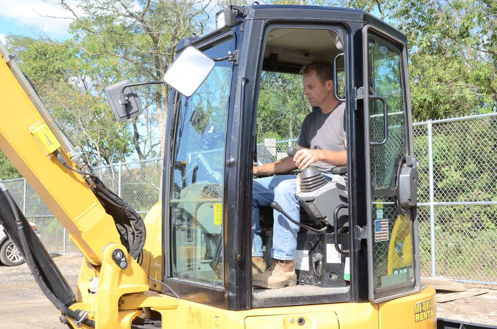 Jim Bodkin, owner of Bodkin Excavating, Bellport, N.Y., tries out the controls.