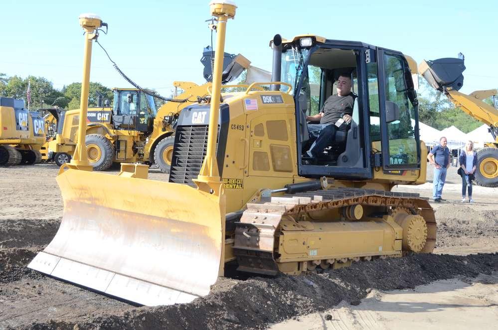 Brendan Boylan, owner of Boylan Excavating, Kings Park, N.Y., tests a Cat D5K.