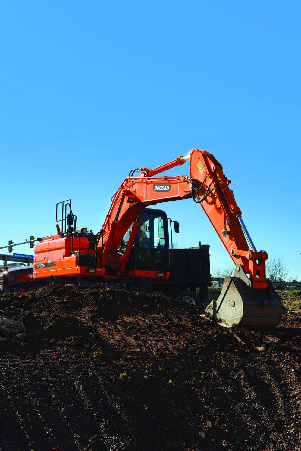 Lane Construction's first DX190W wheel excavator was purchased in 2011.