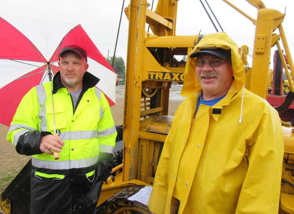 Todd (L) and Mitch Warncke, local Ohio antique construction equipment fans,  came by to see all of the used machines on display.
