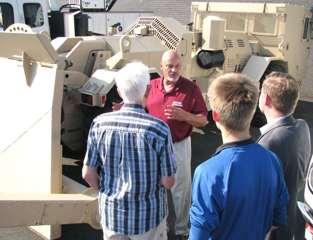 Bill Lewis of Robotics Fabrication, Panama City, Fla., talks about the Hydrema military mine clearing machine with attendees.