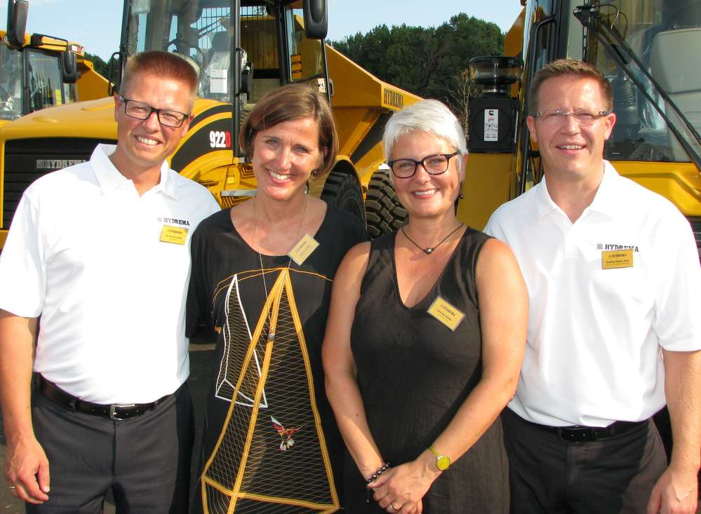 (L-R): Jan Werner Jensen and his wife, Lone M. Jensen, the owners of Hydrema, made the journey from Denmark to join Jette and Kris Binder of Hydrema U.S. for the grand opening celebration.